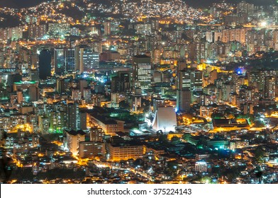 Aerial view of Caracas city, at night, from a lookout in Avila mountain. The western part of the city is visible.