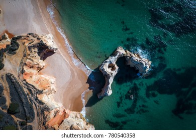 Aerial view of the Careanos Beach in Portimao, Algarve, Portugal; Concept for travel in Portugal and summer vacations in Portugal