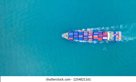 Aerial view cargo container ship carrying container for import and export, business logistic and transportation by ship in open sea