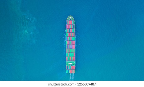 Aerial view cargo container ship carrying container for import and export, business logistic and transportation by ship in open sea.