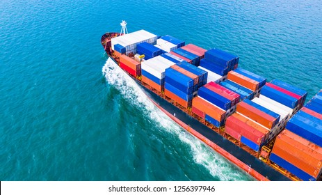 Aerial view cargo container ship carrying container for import and export, business logistic and freight transportation by ship in open sea.