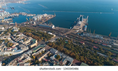 Aerial view of a cargo port with unloading cranes, cargo containers, a logistic zone. Odessa, Ukraine
