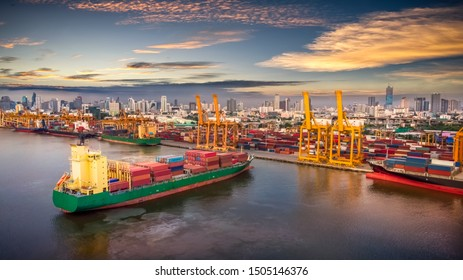 Aerial view of cargo ship, cargo container in warehouse harbor at thailand, container ship in import export and business logistic with sunset