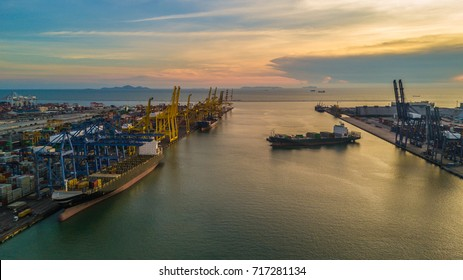 Aerial view Cargo ship or Container ship import export and business logistic at twilight, Unloading crane of cargo ship terminal.