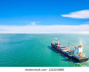 Aerial view of cargo ships that run in the middle of the sea are transported container to the port. Import export and shipping business logistic and transportation of International by ship