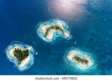 aerial view of a caribbean desert islands in a turquoise water
