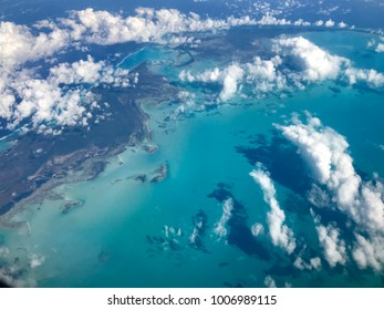 aerial view of the Caribbean islands with blue sea and white clouds