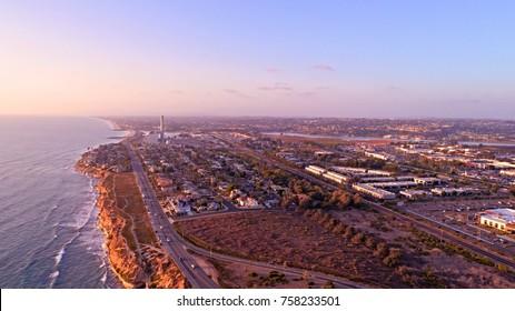 Aerial view of Carlsbad, California coastline, smokestack, and lagoon