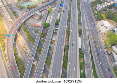 Aerial view of cars driving on highway or moterway. Overpass bridge street roads in connection network of architecture concept. Top view. Urban city, Bangkok, Thailand.