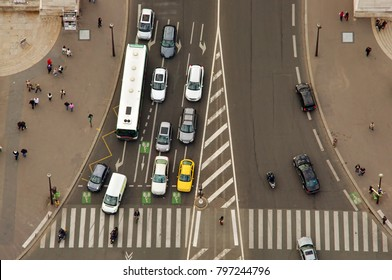 aerial view of cars and people, busy traffic in big intersection. Paris