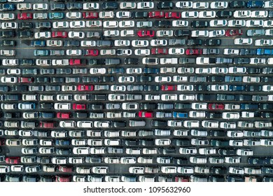 Aerial view of cars ready to be loaded onto a ship for transport overseas