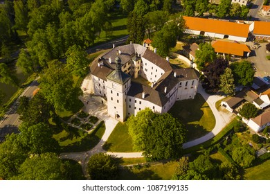 Aerial view of castle in Breznice with park. Renaissance style architecture from drone view. Originally Gothic fortress from 13th century. Breznice in Czech republic, European union.