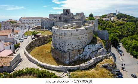 Aerial view of the castle of Monte Sant'Angelo on the Gargano peninsula in Italy, photographed from a drone in flight - Medieval stronghold on a hilltop over the Adriatic Sea