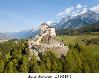 Aerial view of Castle Tarasp (built in the 11th century) in Swiss Alps, Canton Grisons or Graubuendon, Switzerland