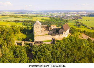 Aerial view of castle Tocnik. Gothic fortress from 14th century. Famous tourist attractions in Czech republic, European union.