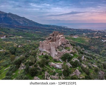 Aerial view of the Castle of Vatika or Castle of Agia Paraskevi at sunset. The castle is located in Mesohori village and has a wonderful view of Neapolis town and Elafonissos island, Laconia, Greece.