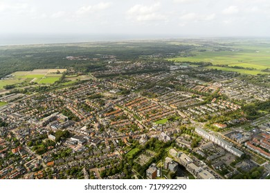 Aerial view of Castricum, Holland. On the clear horizon beautiful cumulus clouds and the Noordzee.