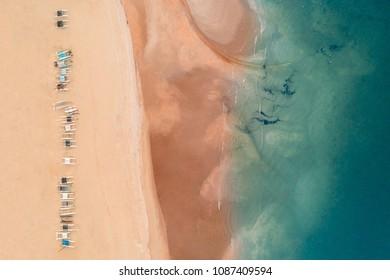 Aerial view of catamaran sailboats on a tropical beach