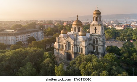 Aerial view of the Cathedral of the Assumption on sunrise, Varna Bulgaria. Byzantine style church with golden domes. Varna is the sea capital of Bulgaria.