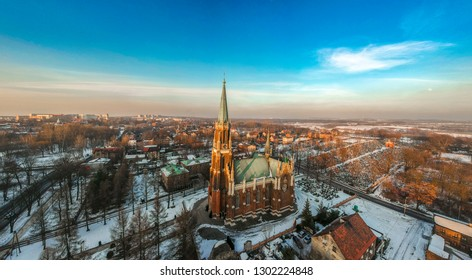 Aerial view of the Catholic Church, Poland during sunset with an empty city in the background.