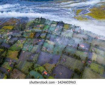 Aerial view of cemoro lawang village at bromo tengger semeru national park with dramatic rolling cloud after sunrise