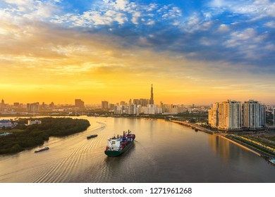 Aerial view of center Ho Chi Minh City, Vietnam with development buildings, transportation, energy power infrastructure. View from the Saigon river  with ships on the river.
