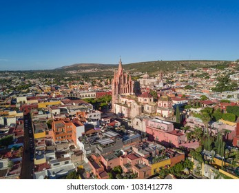aerial view of the center of the magical town of San Miguel de Allende with a clear sky and the Parroquia de San Miguel Arcángel in the foreground