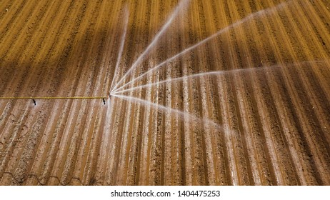 aerial view Center pivot agriculture irrigation machine of crops. An irrigation pivot watering agricultural land. Irrigation system watering farm land.