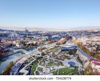 Aerial view of center of Tbilisi, bridge of peace over river Kura