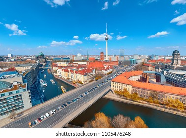 Aerial view of central Berlin on a bright day in Autumn, including river Spree and television tower at Alexanderplatz