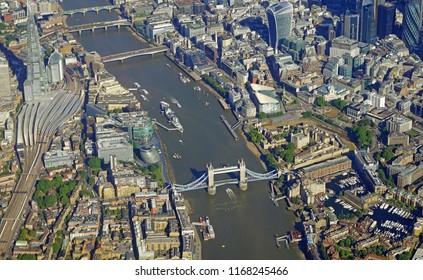 Aerial view of Central London, the London Bridge, and the River Thames from an airplane window