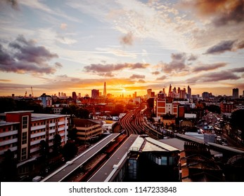 An aerial view of Central London skyline at sunset, taken from above Limehouse station, east London.