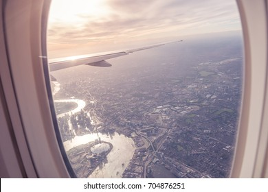 Aerial view of Central London through airplane window vintage colour