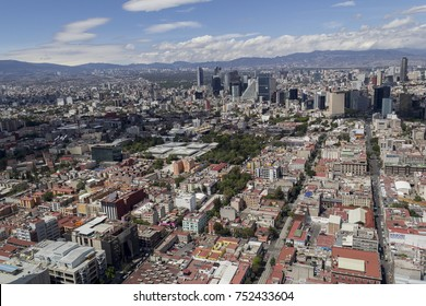 Aerial view of central Mexico City with many high towers of the financial district and pink zone close to Reforma avenue