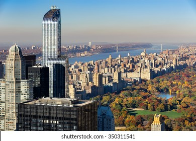 Aerial view of Central Park in autumn with Upper West Side in Manhattan, New York City. The view includes Midtown skyscrapers, the Hudson River and the George Washington Bridge.