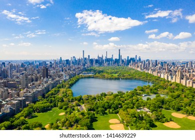 Aerial view of the Central park in New York with golf fields and tall skyscrapers surrounding the park. - Shutterstock ID 1414639229