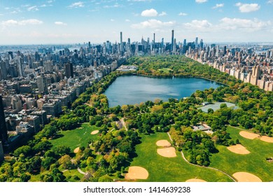 Aerial view of the Central park in New York with golf fields and tall skyscrapers surrounding the park.