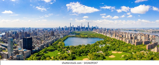 Aerial view of the Central park in New York with golf fields and tall skyscrapers surrounding the park. - Shutterstock ID 1414639247