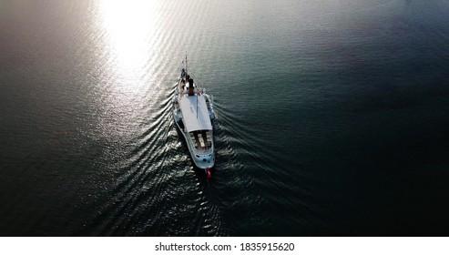 Aerial view of CGN's boat going to Geneva, Switzerland. Vue aérienne du bateau de la CGN allant à Genève, Suisse. Photo prise par un drone en 4k. - Shutterstock ID 1835915620