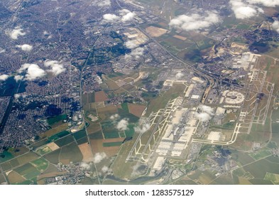 Aerial view of Charles de Gaulle in Paris, France on a sunny, summer day.  The smaller Le Bourget airfield is towards the top of the picture.