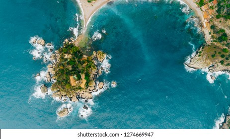 Aerial view of charming coastal Mediterranean small town on Sicily island, Taormina. Beaches of Taormina and south Italy.Travel destination, vacation in Italy concept.Aerial landscape of Bella Isola