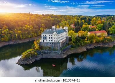 Aerial view chateau Orlik, above Orlik reservoir in beautiful autumn nature. Romantic royal Schwarzenberg castle above water level. Czechia. Orlik castle across the River Vltava, Czech Republic. - Shutterstock ID 1813674415