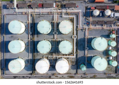Aerial view of Chemical industry storage tank and tanker truck In wailting in Industrial Plant to tranfer oil to gas station. Fuel and power generation, petrochemical factory industry
