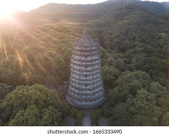 aerial view of a Chinese Pagoda named Six harmony pagoda in the city of Hangzhou in China surrounded by a forest and green trees