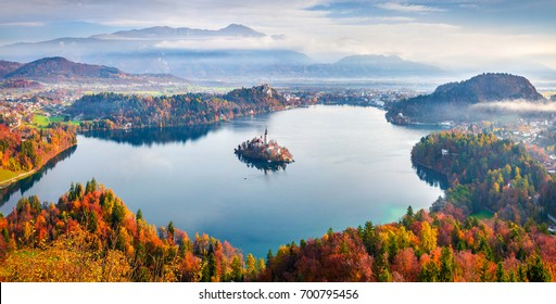 Aerial view of church of Assumption of Maria on the Bled lake. Sunny autumn landscape in Julian Alps, Slovenia, Europe. Beauty of countryside concept background.