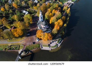 Aerial view of the Church of the Holy Prince Alexander Nevsky in golden autumn. Ust-Izhora, a neighborhood of St. Petersburg. Russia