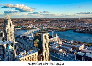 An aerial view of the Cincinnati skyline during the day along the Ohio River