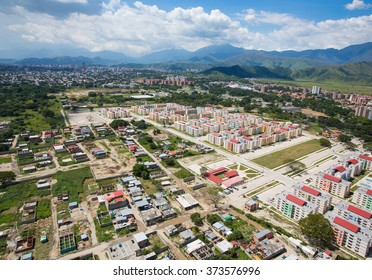 aerial view of the city against the backdrop of the mountains . Venezuela