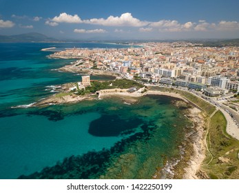 Aerial view of the city of alghero in the distance, sardinia, italy