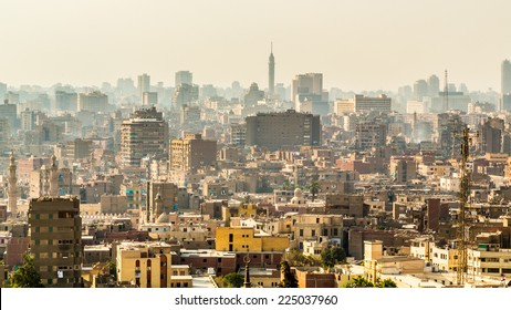 Aerial view of the city of Cairo with densely packed residential homes and buildings